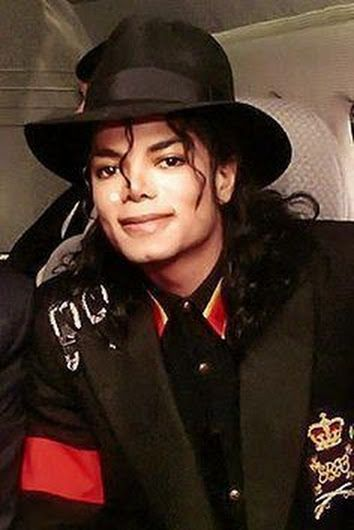 Michael Jackson ❤ He looks happy here, one of my fav pics of MJ. :)