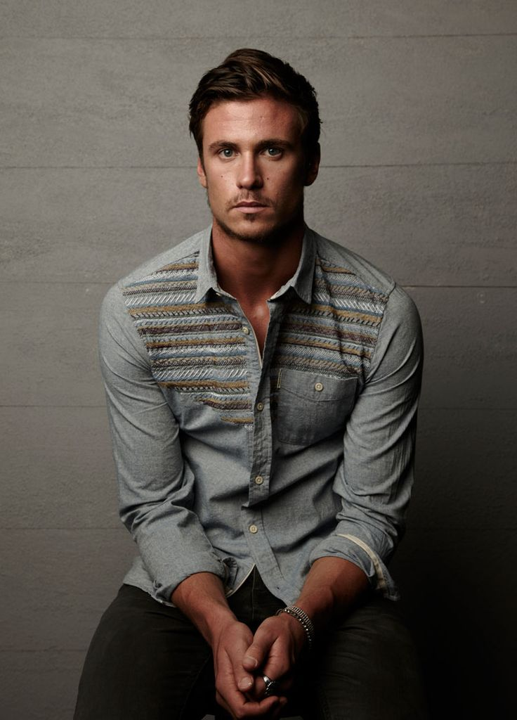 Blue shirt with woven horizontal chest pattern. Worn by Tom Clune.