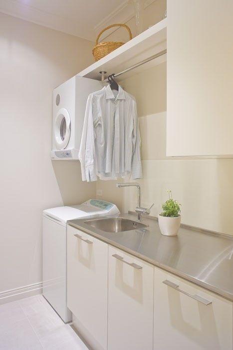 Tiny but Amazing Laundry Rooms You Have to Check Out (20 pics) Messagenote.com Like the idea of using a bar above sink and washer dryer for hanging shirts.