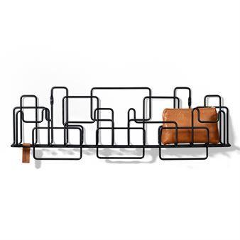Manage Monday är en lekfull klädhängare designad av Ingrid och Olle Wingård för det svenska varumärket Minus Tio. Klädhängaren är tillverkad i lackerat stål med en arkitektonisk struktur vilket ger den ett modernt uttryck. Hängaren skapades speciellt för hallen och sovrummet där den tar minimal plats. De små