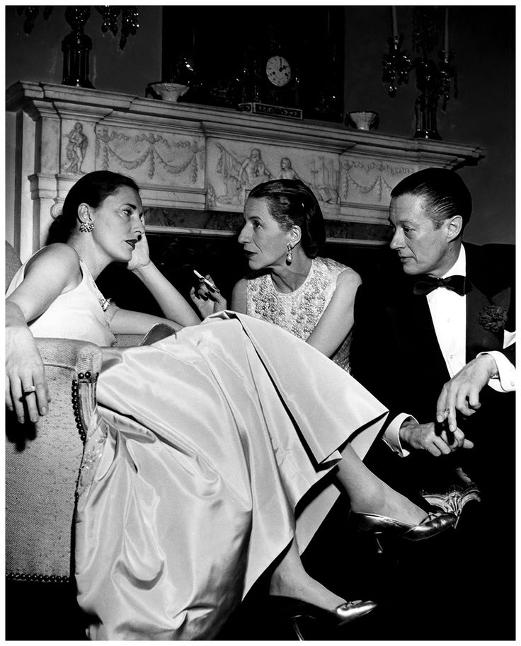 Slim Keith chatting with Diana and Reed Vreeland at Kitty Miller's New Year's Eve party in New York 1952