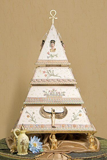 "Incredible tiered pyramid cake with delicate handpainted detail and finely sculpted figures of the Goddess Isis and Queen Nefertiti, topped by a gilded ankh, the Egyptian hieroglyphic meaning ""life."" Created by extraordinary designer/sugar artist Cheri Elder of Cakes by Cheri in Clinton, Missouri...."