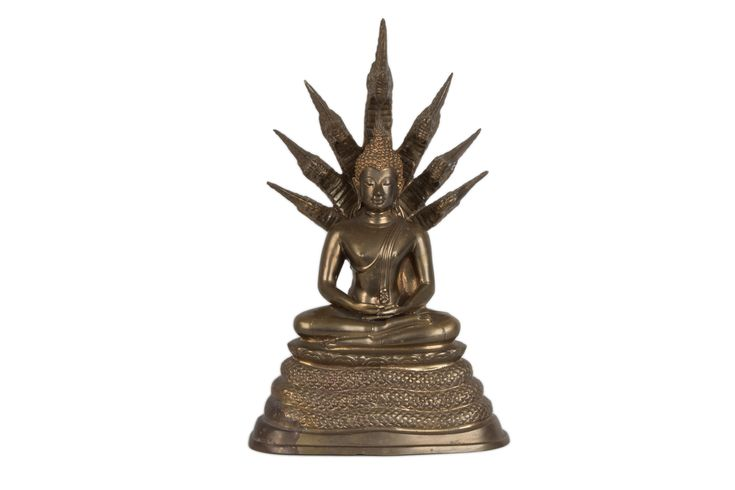 Description Buddha seated under Mucalinda Thailand, the deity seated on the coiled snake, its multiple heads forming a canopy.  Date 20th century  www.collectorstrade.de