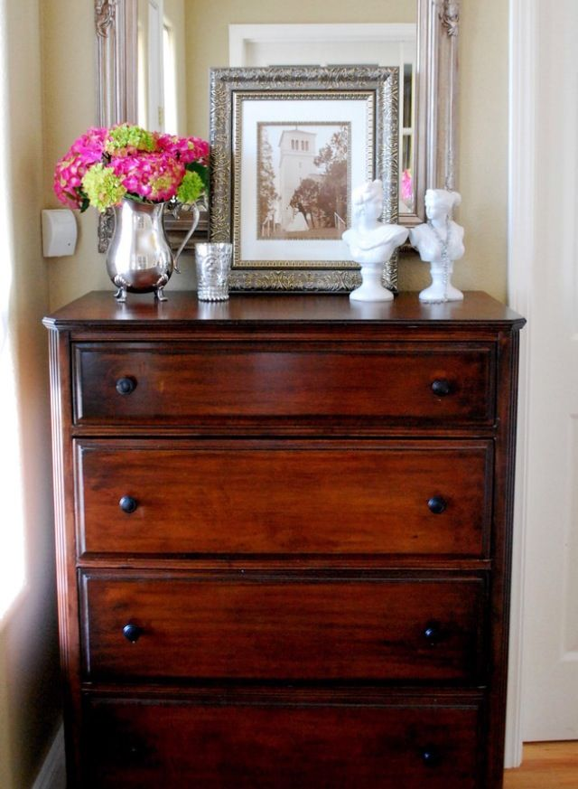 Love the cherry wood dresser with the frames, then some {white,cream,ivory} frames and a vase or something on it..