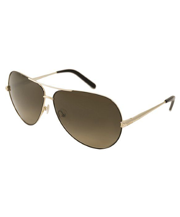CHLOE Gold And Black Aviator Metal CE107S Sunglasses  Retail $296.00 $89.99 Save 70% For a Limited Time! COLOR : Gold ADD TO MY BAG DESIGNER'S NOTES Chloe Sunglasses style CE107S is a retro inspired metal aviator and and features the logo engraved on the temples. The CE107S features adjustable nose pads and plastic temple tips for superb comfort and has lightweight scratch/impact-resistant lenses that provide 100% UV protection. A luxurious and modern look reminiscent of the Chloe brand…