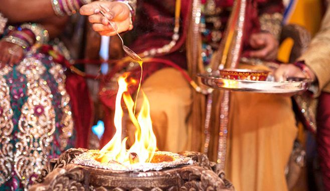 Image result for The bride makes an offering to the sacred fire south indian wedding