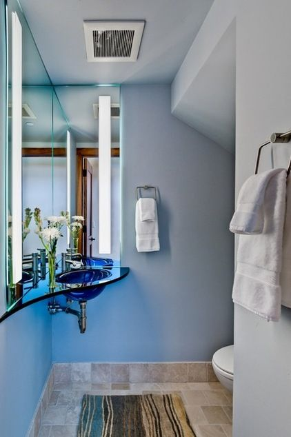 Corner Mirror To Add The Illusion Of More Space In A Small Bathroom