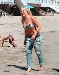 This carefree teen rocking her diesel jeans on the beach.