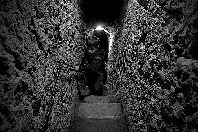 A boy in a stair in Bran Castle. This castle is know as Dracula's Castle in Romania. I hope i didn't scared him too much when i took this shot :)
