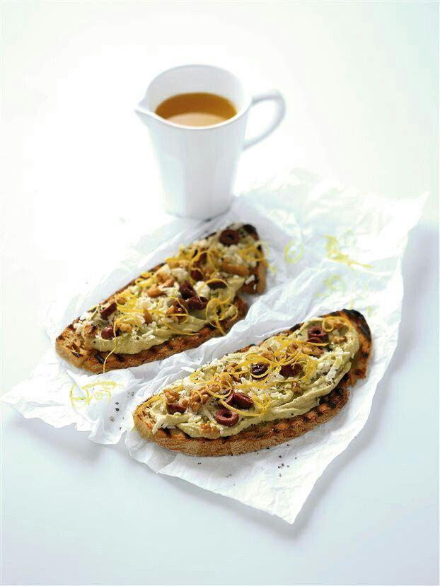 Feta cheese avocado toast with lemon, olives & walnuts