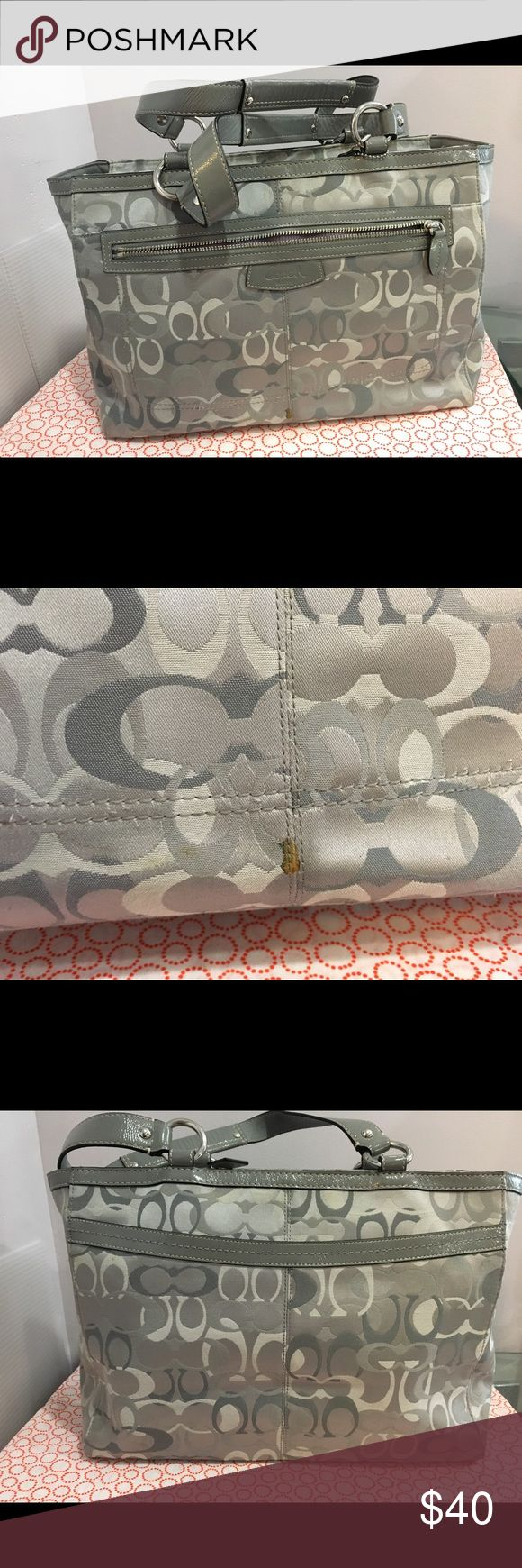 Coach Monogram Large Grey Purse Lightly used. It does have small stains but nothing you can't get off with Purse cleaner. Beautiful clean lavender interior. All functional zippers. It's a pretty good size. Can fit a Columbia shoe box size 10. Great bag for class! Coach Bags Totes