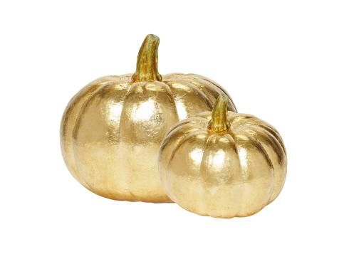 """Pop off the stem of a faux pumpkin; set the stem aside. Apply gold leaf to the pumpkin following the package instructions. Spray the pumpkin with a clear sealer made for gold leaf. Reattach the stem with crafts glue. Pumpkins 6""""-diameter and 3 1/4""""-diameter artificial pumpkins, from $4 each, zimmermanmarketplace.com"""