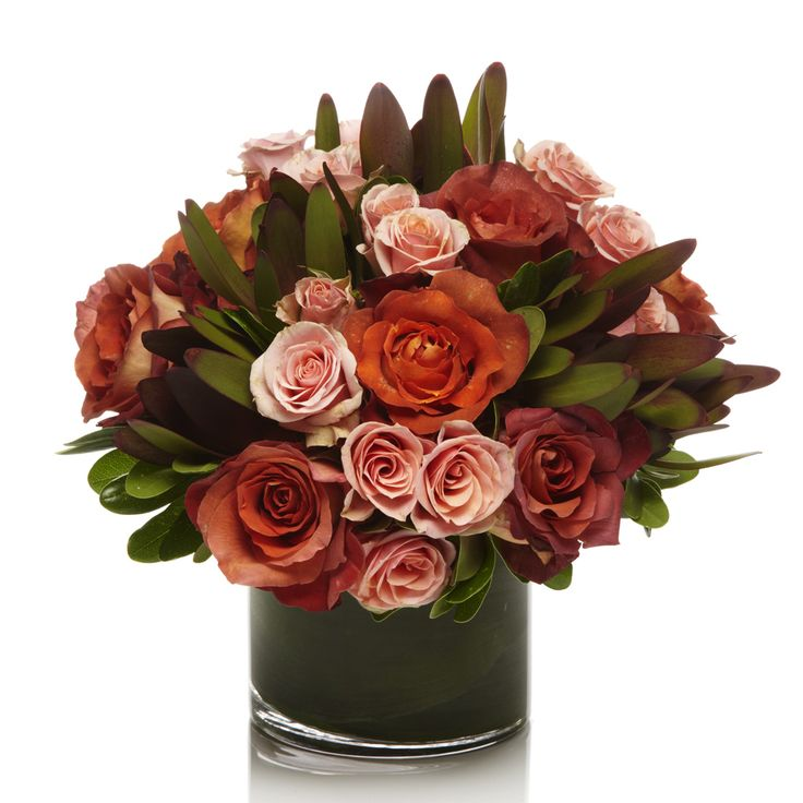 This Classic Collection bouquet features a dusky red palette of coffee break roses, peach spray roses and safari sunset leucadendron