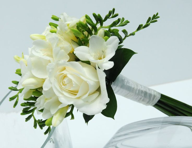 Bridesmaid bouqyet - handtied with ivory lace or ivory ribbon - ivory roses, orchids, fressias, with greenery - small ivy or spruce?