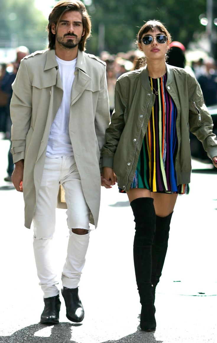 Street Style: The Best Fall Outfits from Milan Fashion Week 2015 - Stylish Milan Couple |  Army green bomber jacket, a colorful striped mini dress, and sexy black suede over-the-knee boots. | @StyleCaster