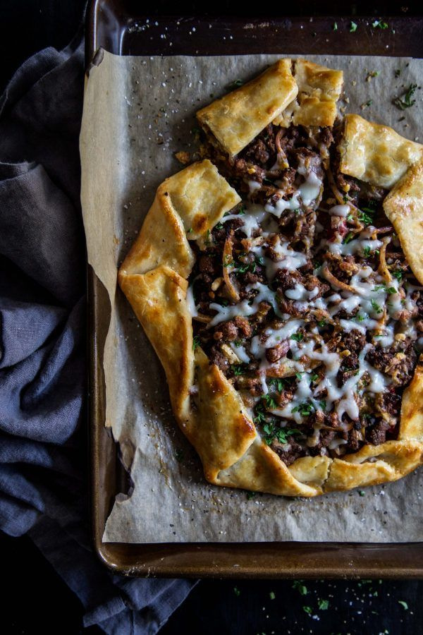 Turkish Lamb Galette is a rustic, pizza like tart that is perfect to serve at any occasion. Spiced ground lamb mixed with hot peppers, spices, and topped with cheese makes this savory tart two snaps up!  Read more at www.climbinggrier...