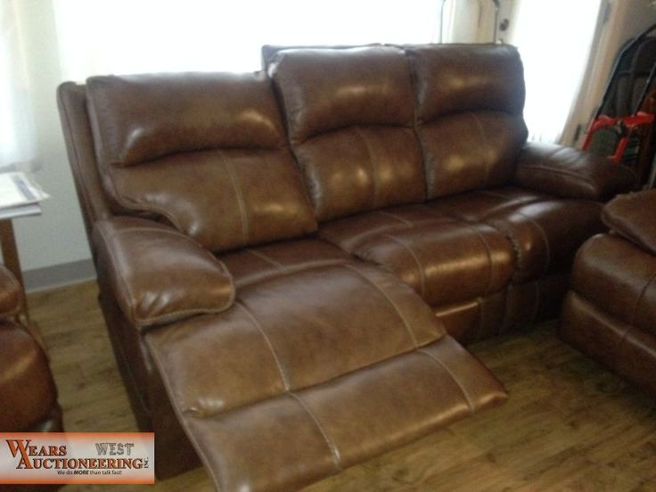 Ashley Furniture Company Double Electric Reclining Leather Sofa. FOR SALE  AT ONLINE ONLY AUCTION.
