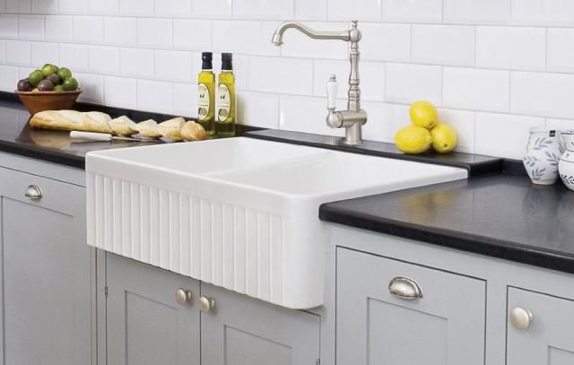 """See 5 """"Farmhouse"""" Sinks That Belong In The Big City: Best For: Ultra Traditional Fluted White Farmhouse Sink"""