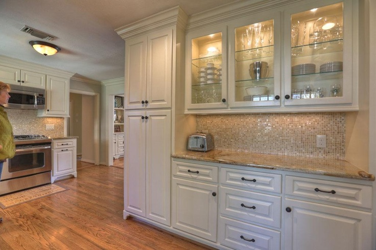 A true bonus...a built in hutch with lighted upper cabinets as part of the breakfast area off the kitchen.