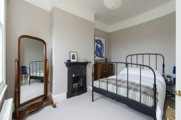 Cast iron bed and fireplace