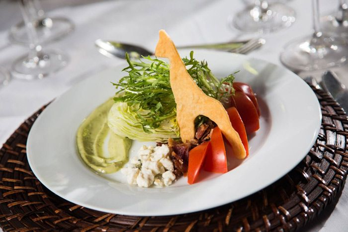 <p> Jewell Events Catering's dinner began with a mini iceberg wedge smeared with Green Goddess sauce. A giraffe-shaped flatbread underscored...