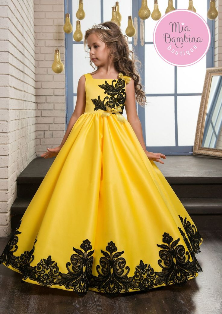 A beautiful Laredo dress will make your little girl look like a princess. This satin gown features a square neckline, wide shoulder straps, fitted bodice and an embellished waistband. There is a capti