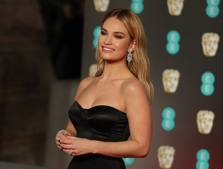 (DANIEL LEAL-OLIVAS via Getty Images) Photos From The Baftas Red Carpet: British actress Lily James poses on the red carpet upon arrival at the BAFTA British Academy Film Awards at the Royal Albert Hall in London on February 18, 2018.