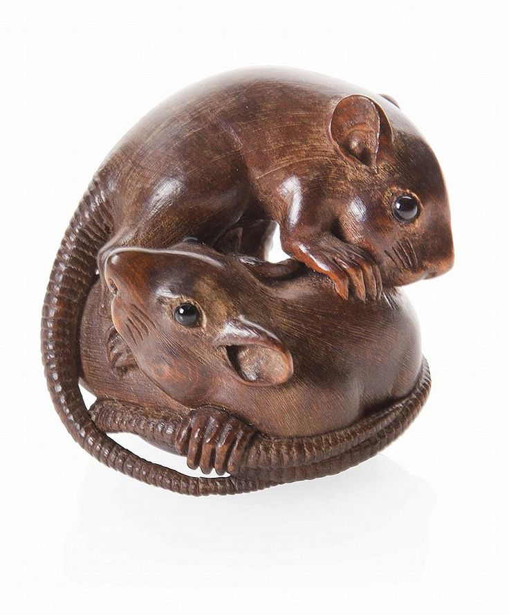JAPANESE CARVED WOOD NETSUKE 19TH/20TH CENTURY depicting a group of three rats tumbling over each other in an elaborate composition, with inlaid eyes, signed Tomokazu 4.5cm high