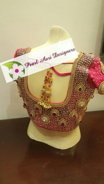 Bridal blouse with heavy stone and rich zardosi work