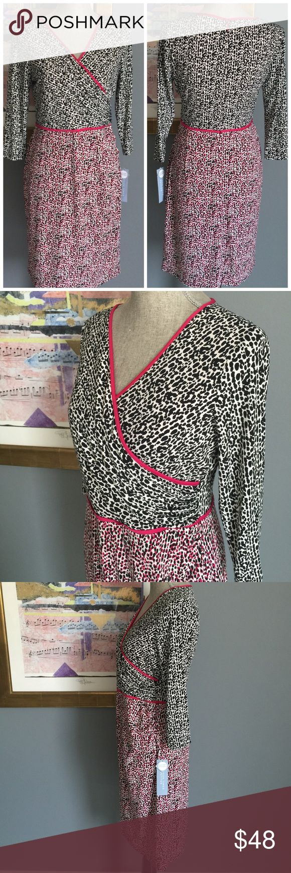 London Times Dress Gorgeous animal print dress from London Times .  Features a lined crossover top part , hidden back zipper , stretchy material .  Made of 95% polyester/5% spandex .  Machine washable . London Times Petite Dresses