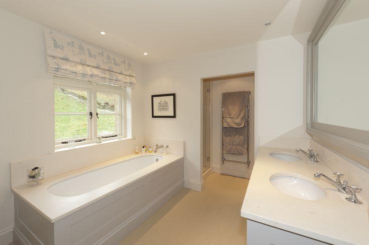 Limestone surround and vanity unit. Unnatural  Flooring