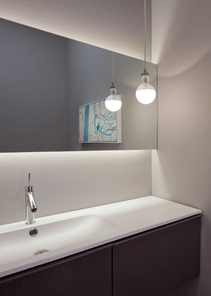 Backlit Mirror In Bathroom With Simple Lighting Fixture