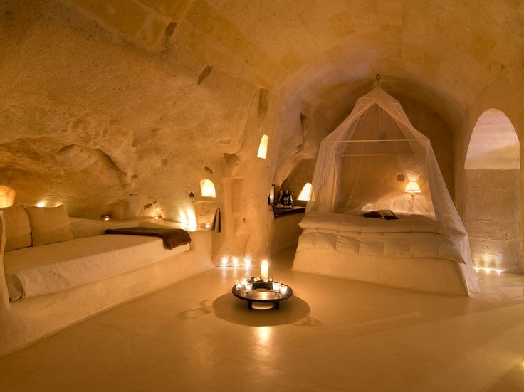 Matera, ItalyHave you ever dreamed of spending the night in a cave? I hadn't either, until I came across the Hotel Sant'Angelo Sassi. Forget about night spent in dark, creepy corners—you'll  be greeted here by opulent canopy beds, cozy candlelight, and oversize bathtubs. In short, it's a perfect hideaway for relaxing or romancing on your next getaway.