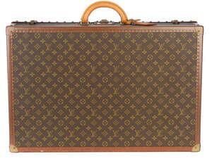 LOT:312   LOUIS VUITTON - a Monogram Alzer 70 hard suitcase.