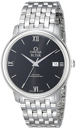 Stainless steel case with a stainless steel bracelet. Fixed stainless steel bezel. Black dial with silver-tone hands and stick hour markers. Roman numerals mark the 3 6 9 and 12 o'clock positions. D...