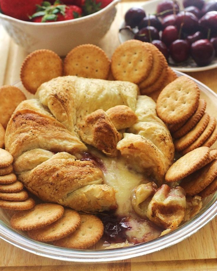 Baked Brie with Raspberry Jam. Brie topped with raspberry jam and baked in a puff pastry. Serve with crackers.