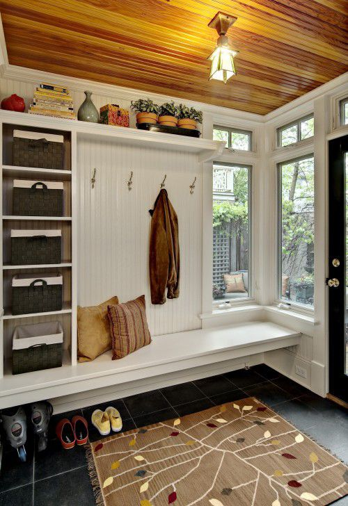 Stylish Foyer and Entryway Ideas - Style Estate -like that the bench is suspended so that dirty, wet shoes can be placed underneath.