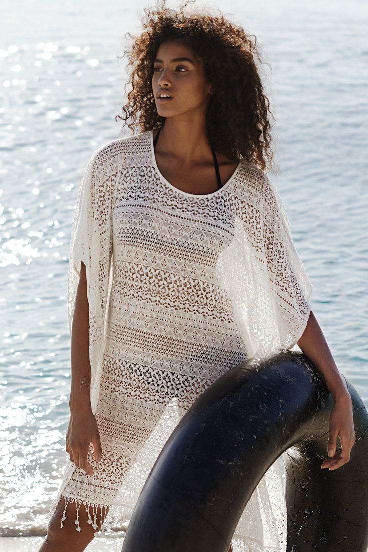 Throw on this white lace kaftan over a cute bikin, or style over a tank top and jeans to take it from beach to street. | H&M Divided