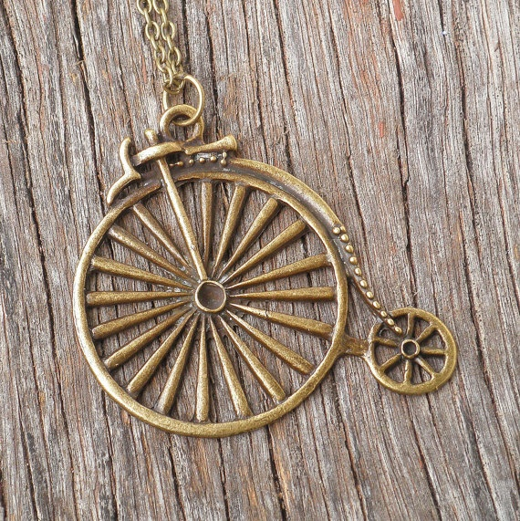 Antique Brass Penny Farthing Bicycle Pendant Necklace $18.50  Who doesn't love an old school looking bike? Cuter!!