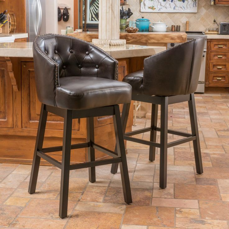 Features:  -Bonded leather with wood frame.  -Includes: Two (2) bar stools.  -Swivel functionality.  -Upholstery color: Brown.  -Assembly required.  Frame Material: -Wood.  Frame Finish: -Espresso.  S