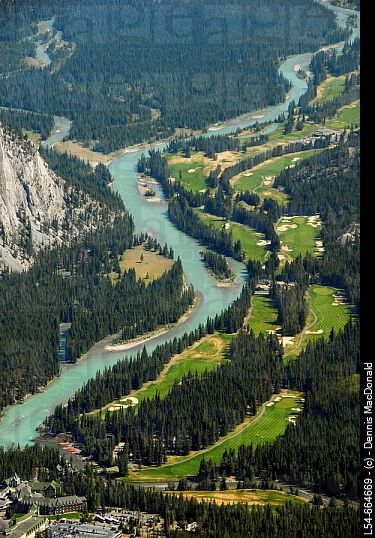 Bow River and Fairmont Banff Springs Golf Course, Banff, Alberta. Notice the colour of the water, it is glacier water and had a lot of powdered rock in it which makes it green and murky.