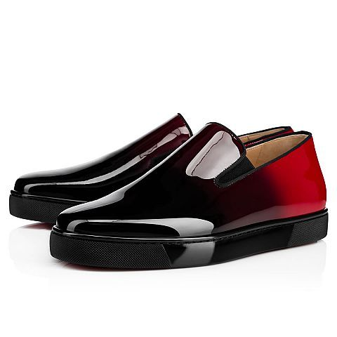 """Hang loose in luxury this season with """"Boat Man Flat,"""" your guaranteed go-to for days of leisure. In black-to-red dégradé patent leather, this slip-on style brings a signature Christian Louboutin touch to your more casual looks."""