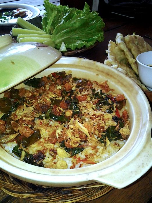 Boemi Joglo's specialty, nasi liwet - rice cooked in coconut milk and chicken broth with spicy fried condiment. Photo ...