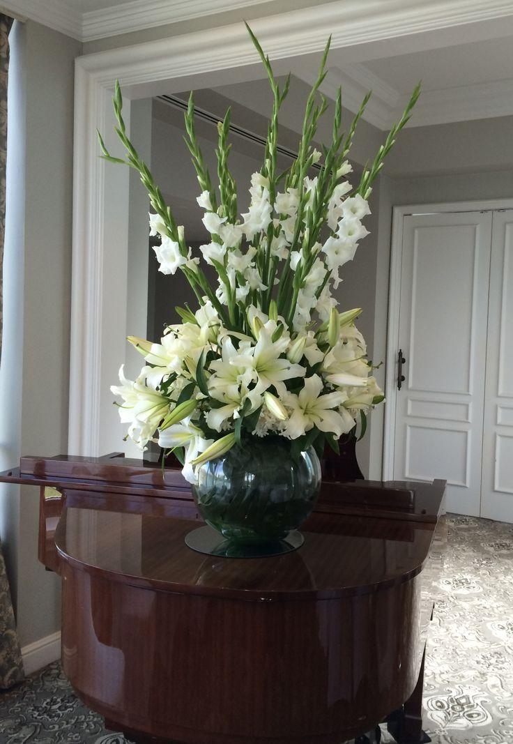 Gorgeous white wedding reception floral arrangement. Gladiolas, lillies. Fish bowl vase. Great taste by this bride.  Made by Willis Designs, Brisbane