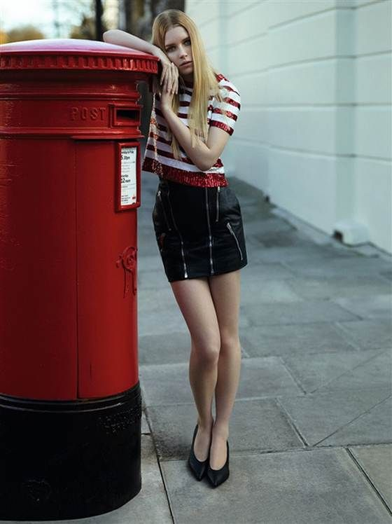 Lottie Moss models next to an English post office box. The teen grew up in England in relative anonymity.