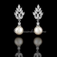 The marquise CZ cluster that sits atop these off-white pearls give this set of bridal earrings their vintage feel. They are about 1 and 3/8 inches long, post ba