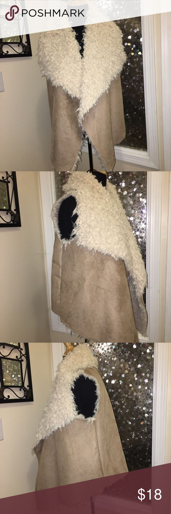 Gorgeous Cream/Tan Faux Leather/Fur Hi-Low Vest Beautiful Cream Faux Fur and Faux rawhide asymmetrical cut vest! Never Worn! hint of mint Jackets & Coats Vests