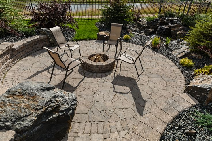 Great Flagstone patio with a Stone Oasis Firepit kit.