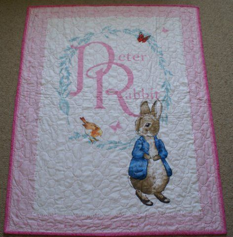 Australian Handmade Gifts - Peter Rabbit Cot Quilt - https://www.highlandshandmade.com.au/peter-rabbit-cot-quilt/ - Peter Rabbit Pink  Beatrix Potter's Peter Rabbit story panel  100% cotton front and backing fabric with lightweight wadding.  Machine quilted with heart shapes. Washable with a gentle cycle.  Suitable for a little girl. Size 110 x 88 cms  Made in the Southern Highlands of country NSW by Dennis Buck.  Time taken to make this was 6 to 8 hours.  Ple