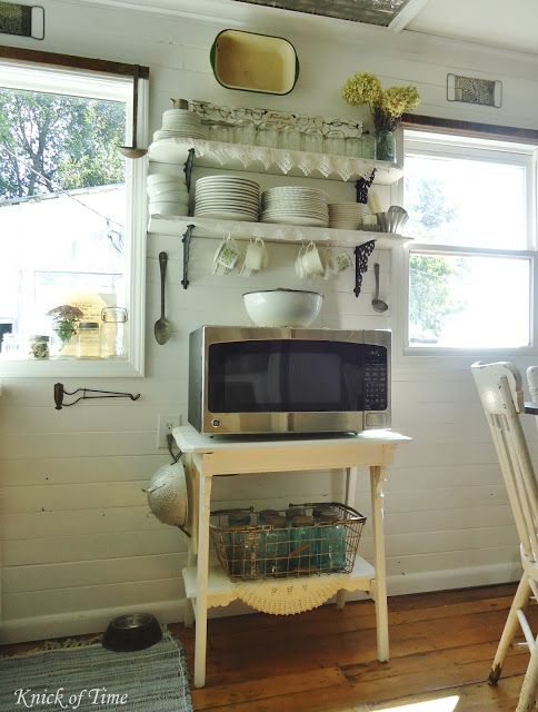 Farmhouse Kitchen Remodel - A Room with a View - Knick of Time.  I like how she mounted the metal dish pan on the wall.  Want to do this in our laundry room, but yet still be able to pull it down & USE it!